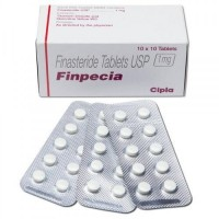 A box and three strips of generic Finasteride 1mg tablets